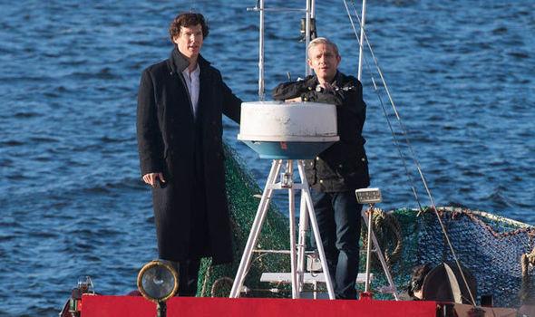 Benedict Cumberbatch standing on boat
