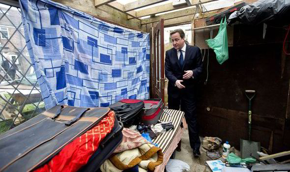 David Cameron is showne around a house which was raided earlier in the day by Immigration officers