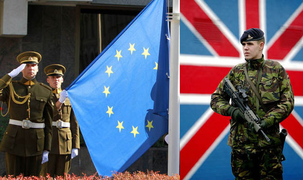 A British trooper, right, and soldiers salute the EU flag, left