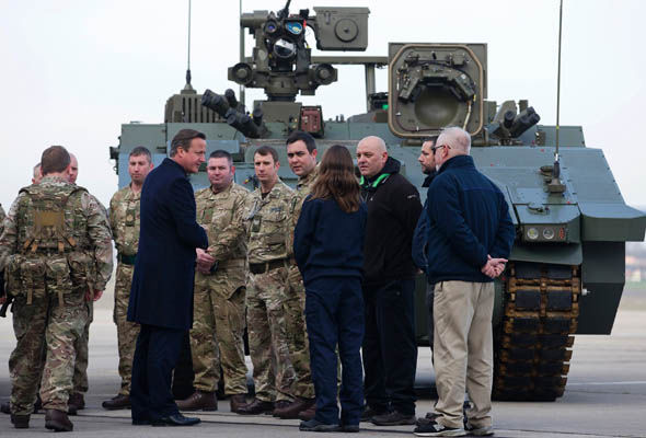 David Cameron in front of an army Ajax
