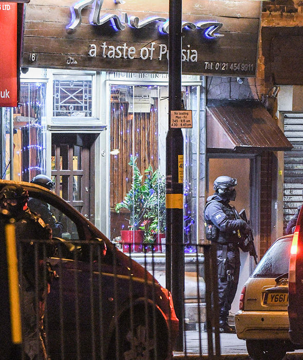 Heavily armed police undertook a raid on this address