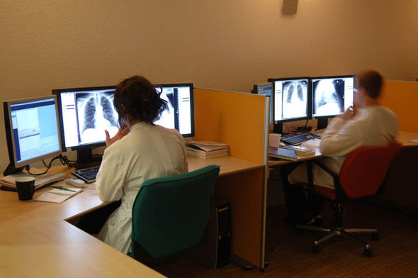 Doctors looking at patient scans