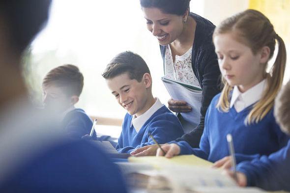 A teacher talking to a pupil