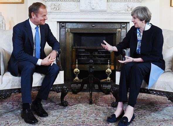 Donald Tusk talking with Theresa May