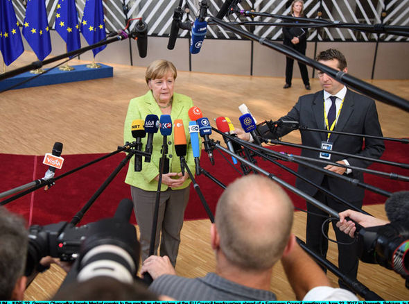 Angela Merkel speaking to journalists at the EU summit