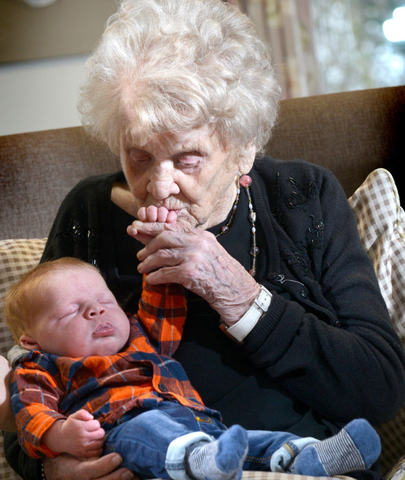 Hilda holds her new born grandson