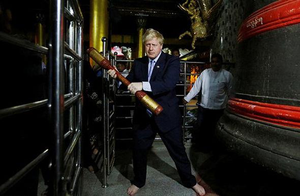 Johnson engaging in Burmese customs