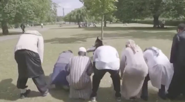 The men pray in the video
