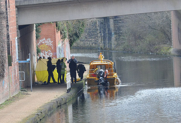 A tent has been set up on the towpath with officers standing guard