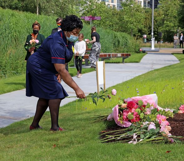 NHS staff leave roses as a tribute