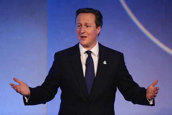 David Cameron with his arms outstretched