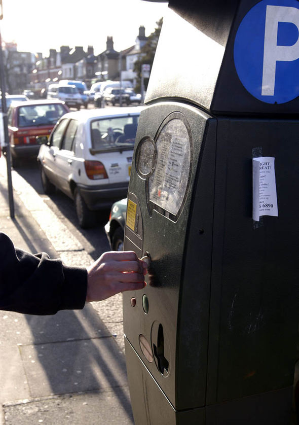 A person paying for parking