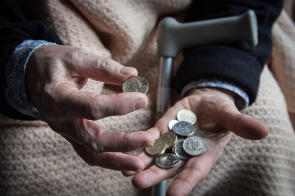 An elderly person holding money