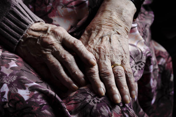 Two elderly hands