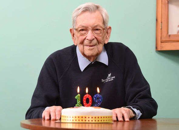 Robert Weighton next to his 109th birthday cake