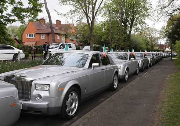 A rows of silver Rolls Royces