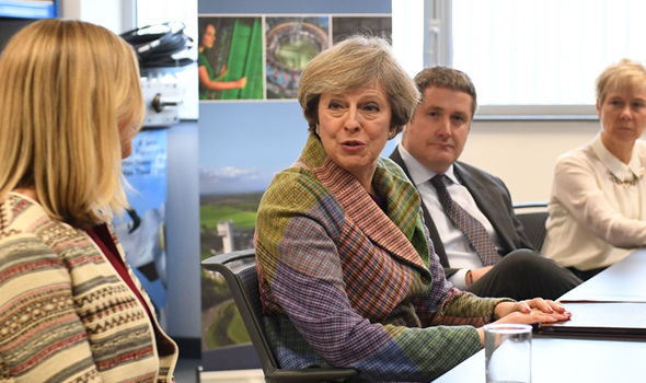 Theresa May spoke with local business leaders in Warrington on Monday ahead of the landmark ruling