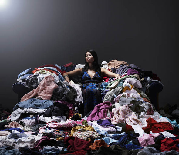A woman on a throne made of clothes