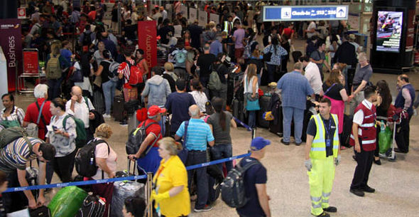 A crowd of passengers at Heathrow