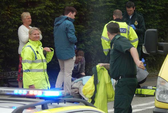Onlooker watch on as paramedics rush over