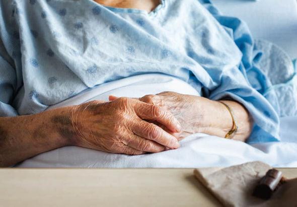 older woman sitting down