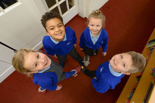 Four children smiling
