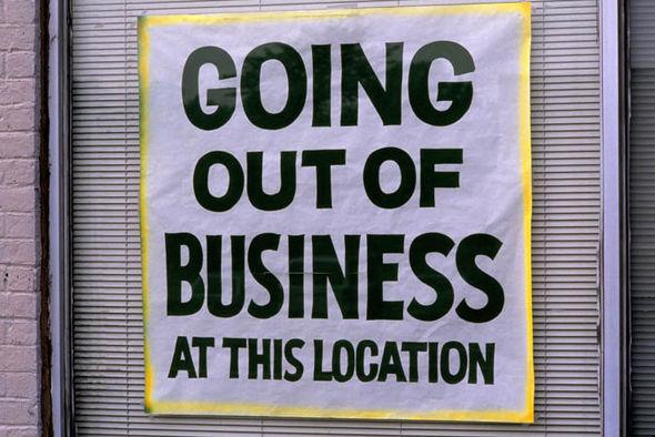 Shop closure sign in window