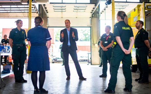 Prince William talks to the ambulance staff.