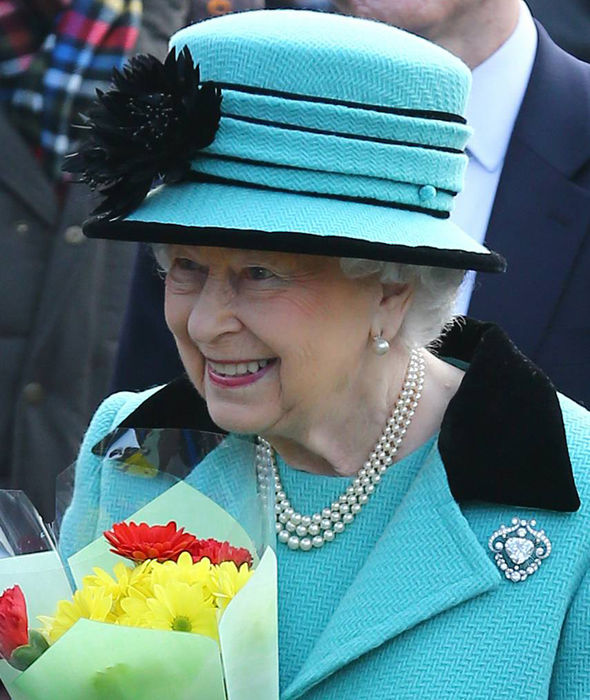 The Queen was handed a bunch of flowers upon her arrival