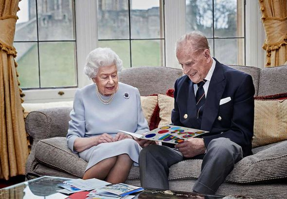 Wedding anniversary: Philip and the Queen open cards on their wedding anniversary last year