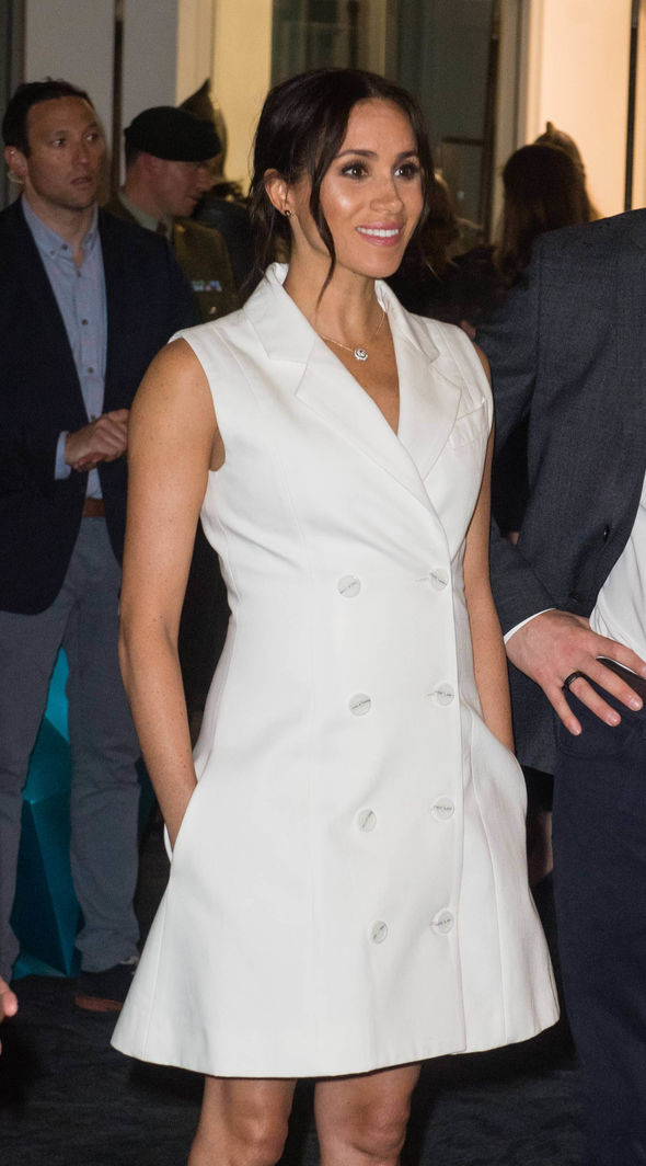 Meghan with her hands in her pockets