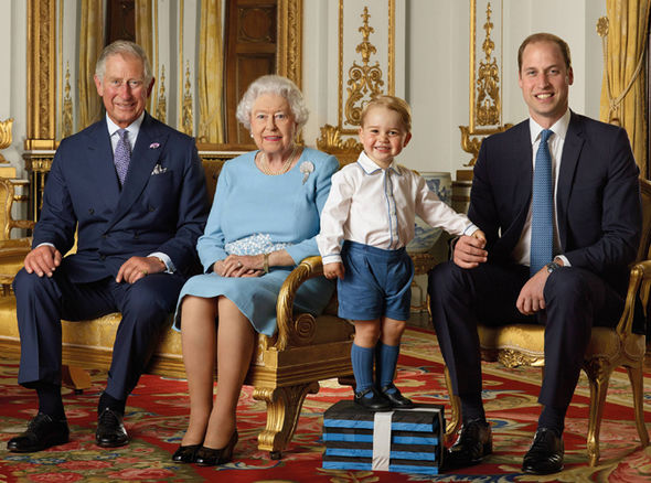Prince George cheekily stands on foam blocks