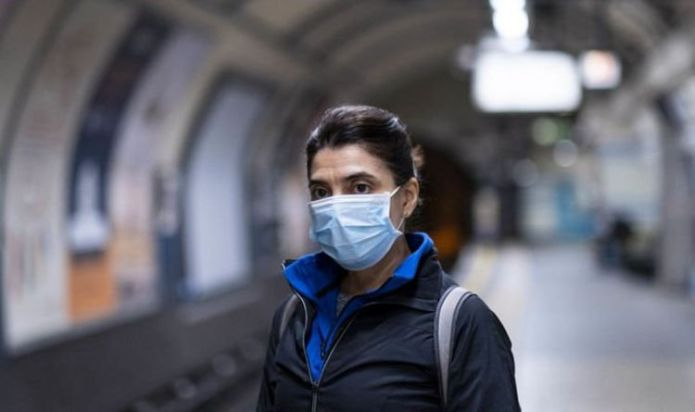 End face masks and social distancing on June 21 - top scientists demand