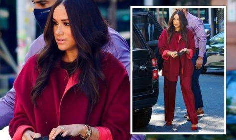 Meghan Markle 'stuns' fans in red trouser suit on New York school visit - 'looks so good!'