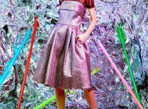 model wearing pink metallic dress and black top