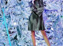 model in silver room wearing silver black dress