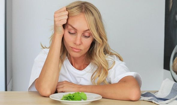 Keto diet explained: woman looking at salad