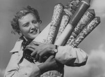 A young woman grasps a armload of fireworks