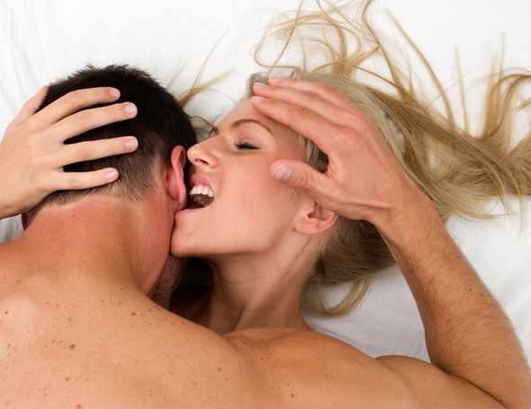 Blonde woman and man in bed together