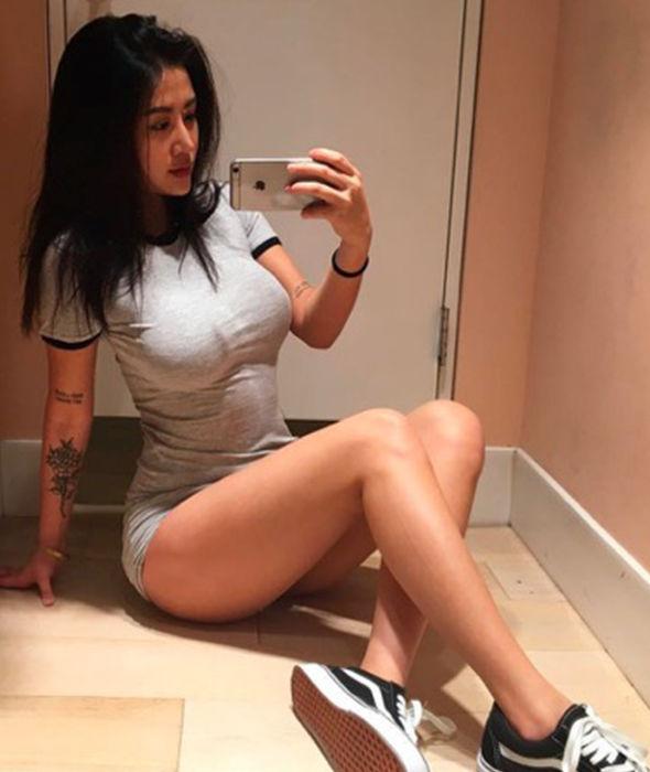 Carina Linn posing on the floor for Instagram snap