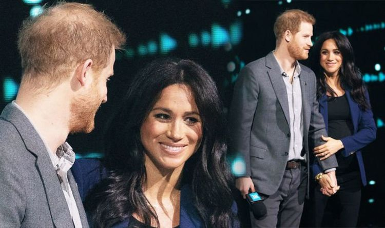 1097401 Meghan Markle has a 'rather possessive' signature move for outings with Prince Harry