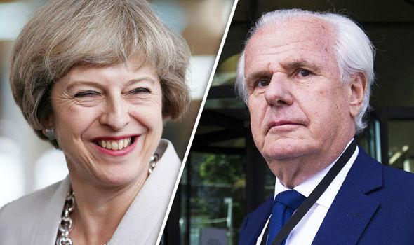 Theresa May and Lord Paul Myners