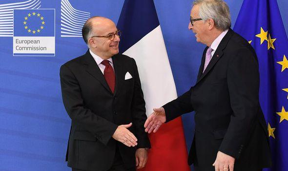 Jean-Claude Juncker greets Bernard Cazeneuve