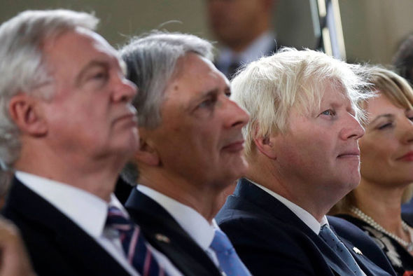 Davd Davis, Philip Hammond and Boris Johnson listen to the PM's speech