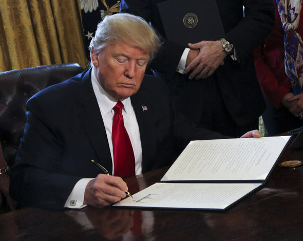 Donald Trump at work in the White House