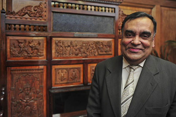 YK Sinha smiling