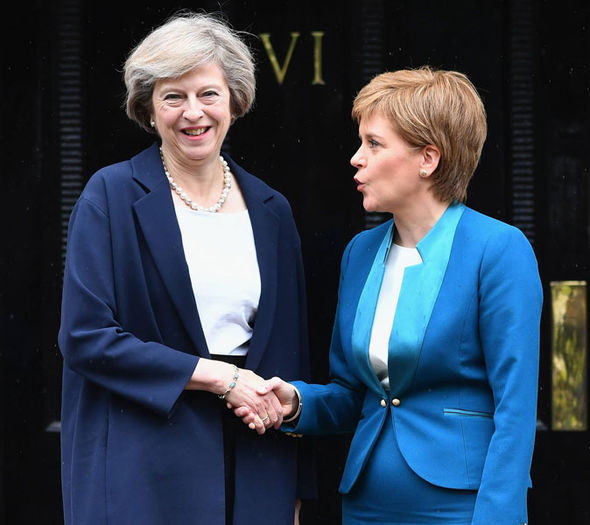 Image result for image of theresa may and nicola sturgeon