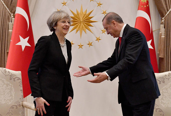 Theresa May is greeted by the President Erdogan at the Presidential Palace in Ankara