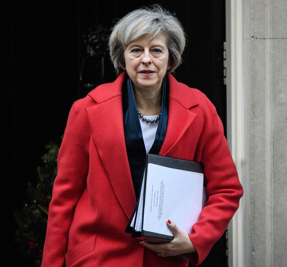 Prime Minister Theresa May leaving Downing Street