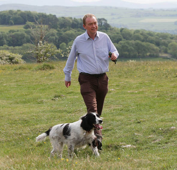 Tim Farron goes for a walk with his dog